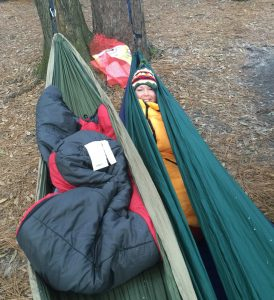 Thalita bundled up in her sleeping bag trying to stay warm at Suwannee River State Park.