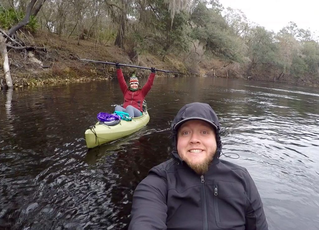 Attempting to stay warm and happy on the Suwannee River.