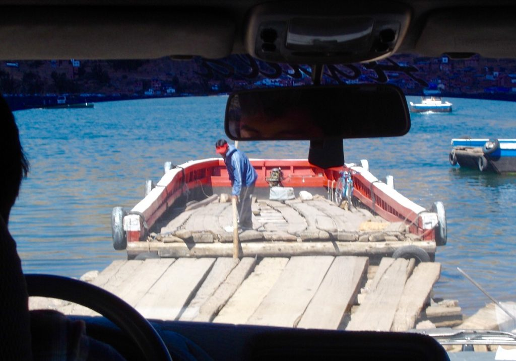Our taxi boarding a ferry across to cross the small section of Lake Titicaca en route to Copacabana, Bolivia.