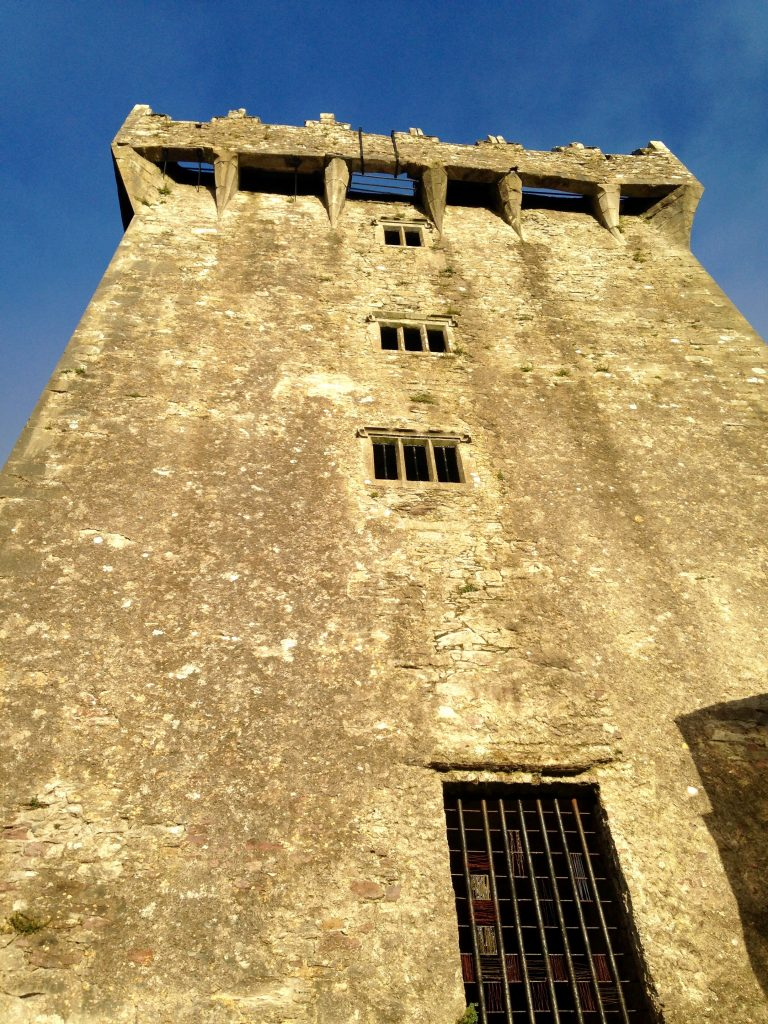 Looking up the wall of the Blarney Castle to the Blarney Stone